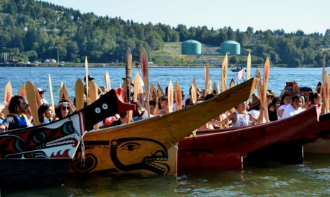Canoes arrive at Whey-Ah-Wichen - Kinder Morgan pipeline facility in background